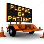 1324676_stock-photo-please-be-patient-construction-sign