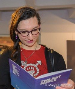 Exhibition guest enjoying the Twilight People booklet - special edition